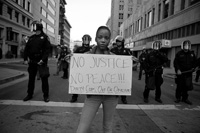 Protestor at Oscar Grant rally. Photo by Geoff King