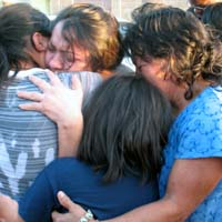 Sandra's family rushes to embrace her after her release from three months in detention. Photo by Valeria Fernandez