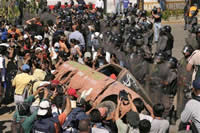 Protesters push a car to form a barricade near Oaxaca University.  Source: AP/Pablo Spencer