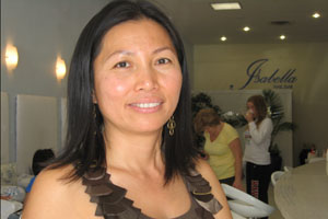 Uyen Nguyen, owner of Isabella Nail Bar in Oakland, California, is committed to using less toxic nail salon products.  Credit: Pauline Bartolone