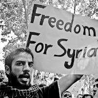 """Protest infront of the Syrian Embassy"" by Flickr (cc) user Maggie Osama."
