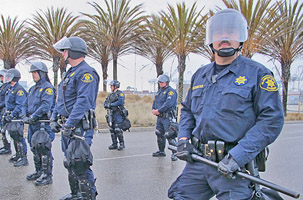 Officers form a line during a Port of Oakland Occupy Rally. Photo by Irene Florez