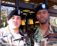 Sgt. Jose Delao (left) and Sgt. Luis Green prospect for new recruits outside a San Leandro, Calif. supermarket. Source: Justin Beck